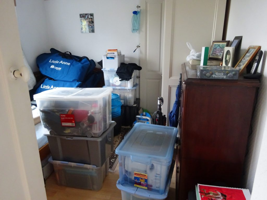 Boxes piled high in room